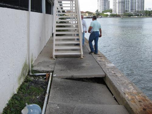 damaged seawall and sidewalk